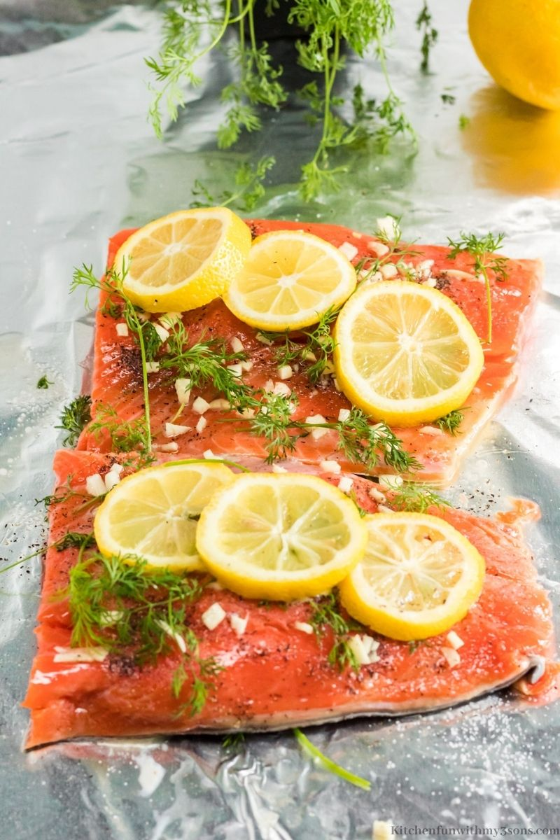 The complete and prepared salmon with more lemon and dill on top.