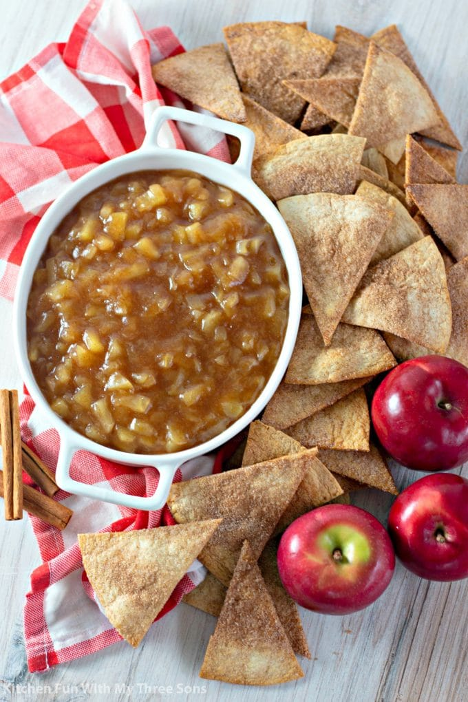 Apple Salsa with Cinnamon Sugar Chips with cinnamon sticks and a red checkered napkin