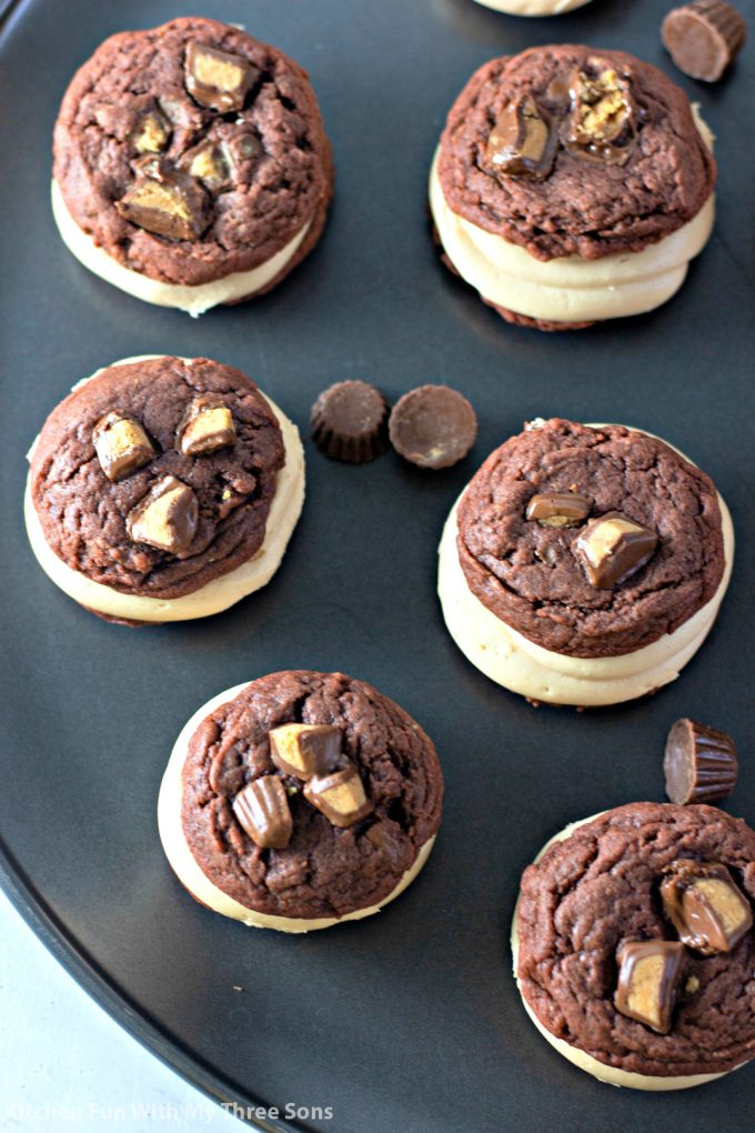 Chocolate Peanut Butter Cup Sandwich Cookies on a cookie sheet