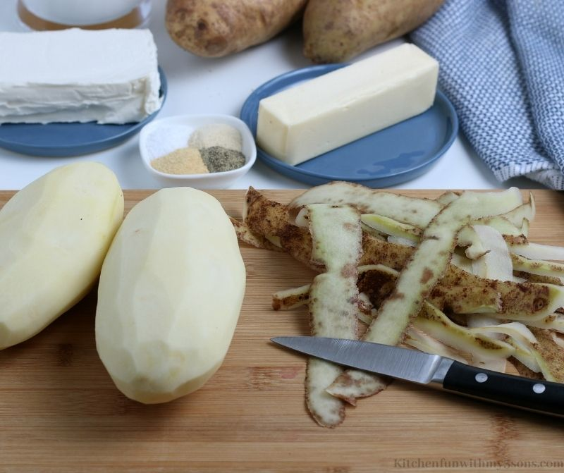 Your potatoes peeled on a cutting board.