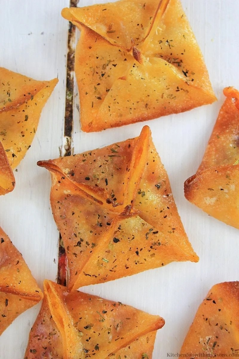 Easy Pepperoni Pizza Wontons Snack on a white wooden table.