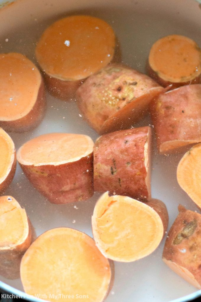 boiling sweet potatoes in a pot of water