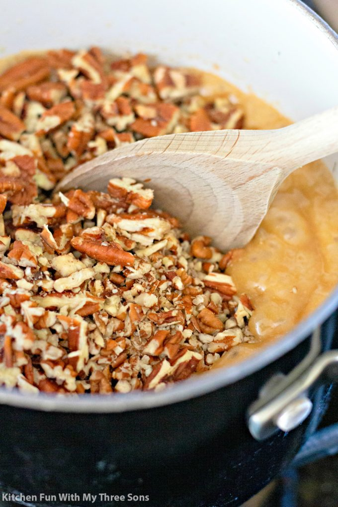 mixing pecans into toffee