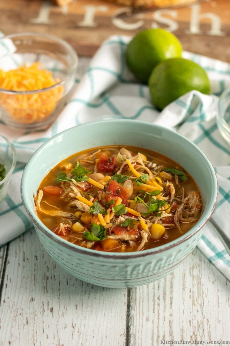 Instant Pot Chili Lime Chicken Soup Recipe with a patterned blue cloth around it.