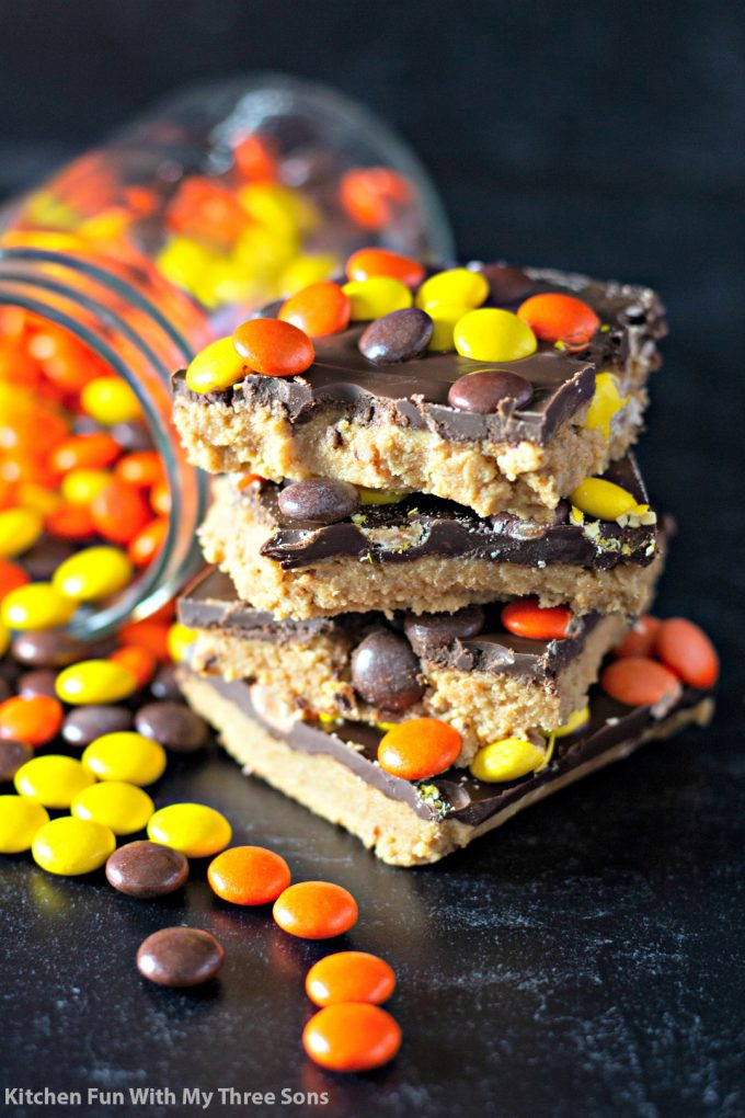 No Bake Reese's Peanut Butter Bars next to a jar of Reese's Pieces