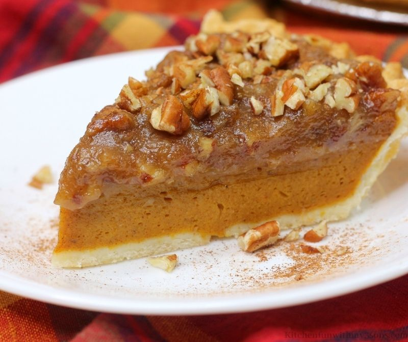 Close up of the Pumpkin Pecan Pie with chopped pecans.