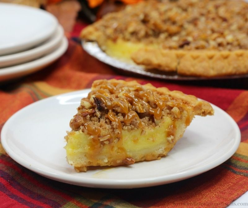 Streusel Buttermilk Pie Recipe with fall decorations behind it.