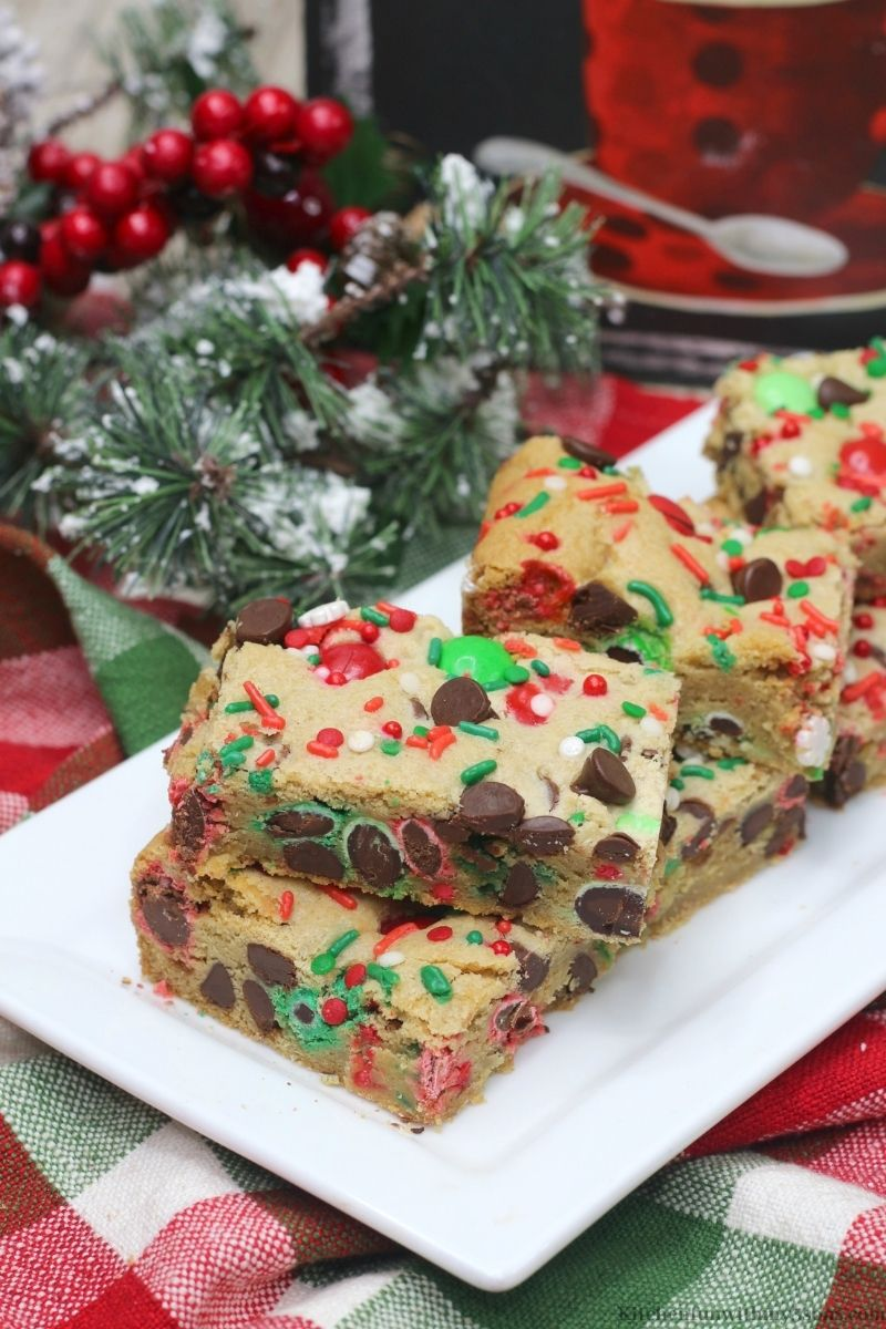 Christmas Cookie Bars with snow frosted decorations next to it.