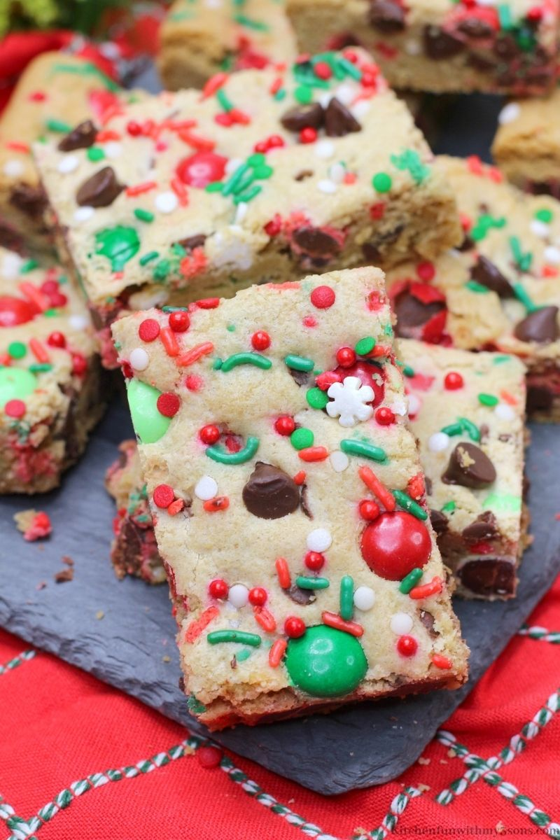 Christmas Cookie Bars on a gray slate serving platter.