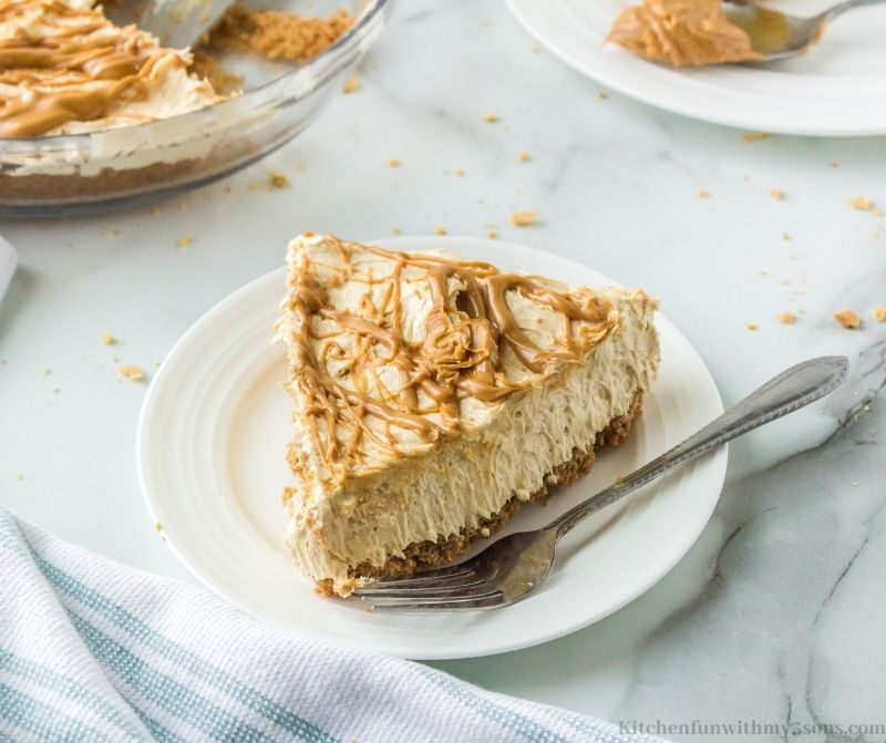 A slice of the Creamy Peanut Butter Pie Recipe on a serving plate.