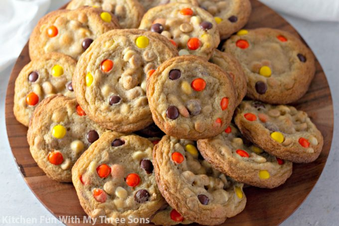 Reese's Pieces Cookies on a wooden platter