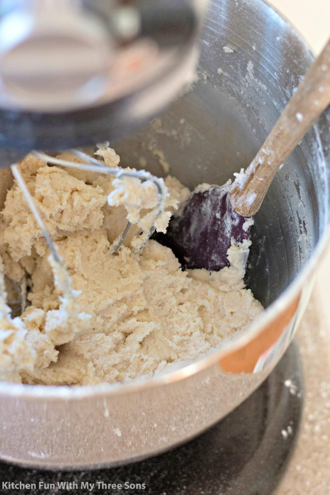 mixing cookie dough in a metal mixing bowl