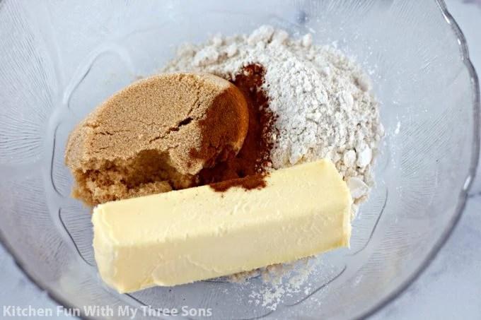 brown sugar, butter, cinnamon, and flour in a clear bowl