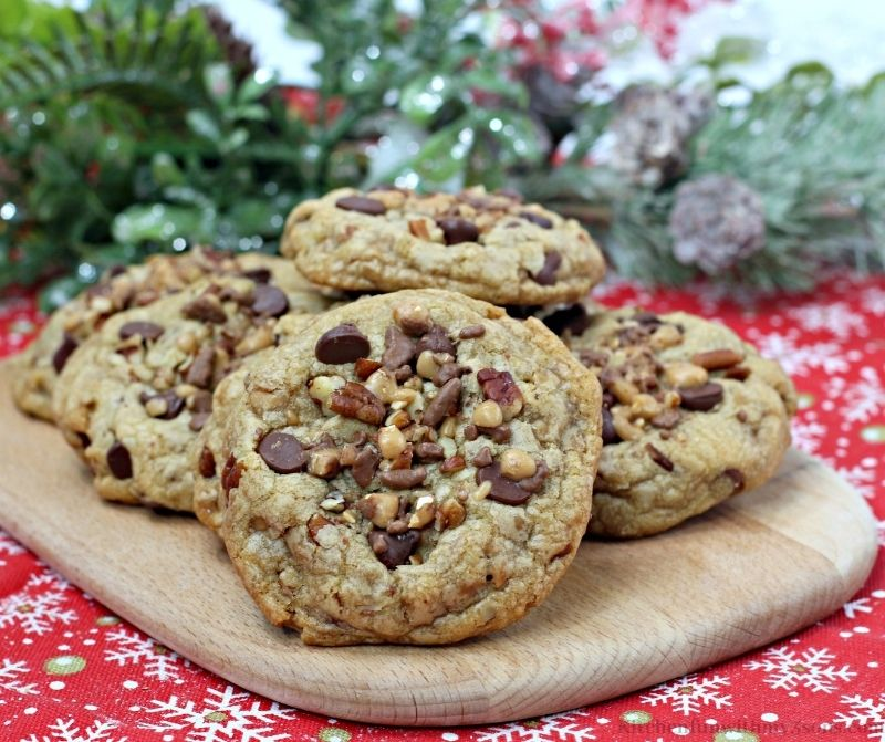 Chocolate Chip Pecan Toffee Cookies on a Christmas cloth.