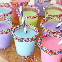 Birthday Cake Shots made with Rum Chata, Cake Vodka and vanilla frosting around the edges are every grown-ups favorite way to celebrate getting older.