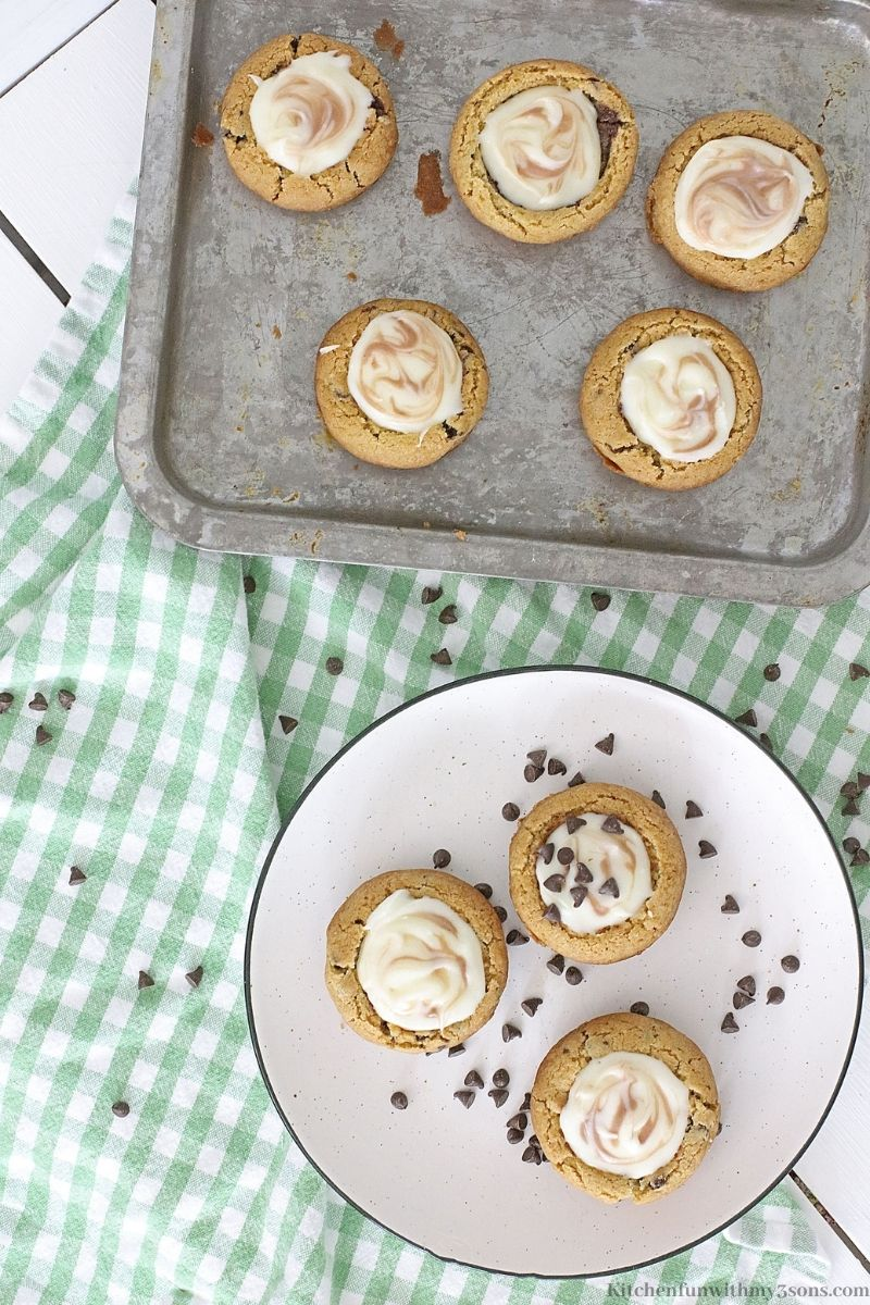 Mini Chocolate Chip Cookie Cheesecakes on a tin sheet pan and platter.