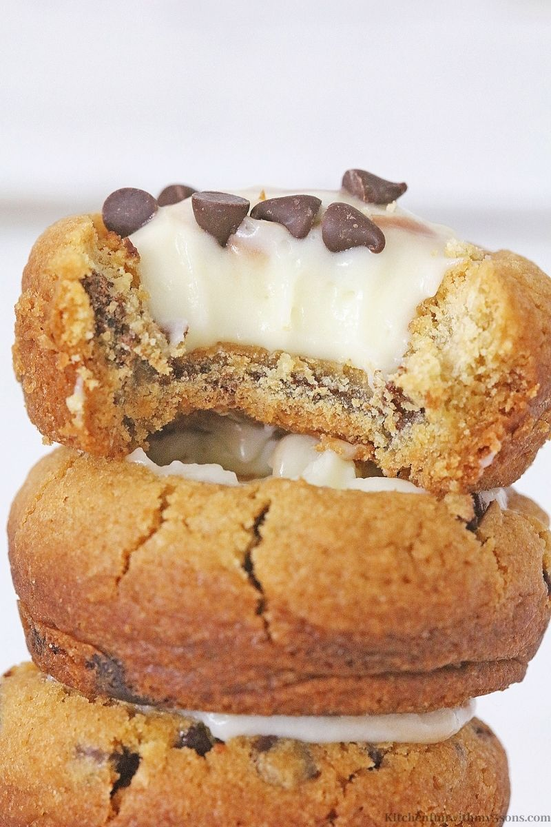 One of the Mini Chocolate Chip Cookie Cheesecakes with a bite taken out of it.