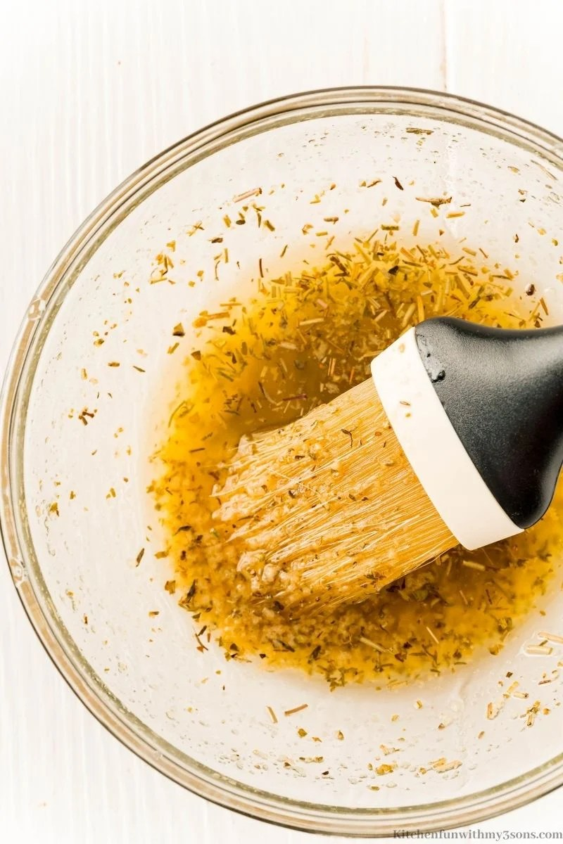 Combining the melted butter and seasonings.