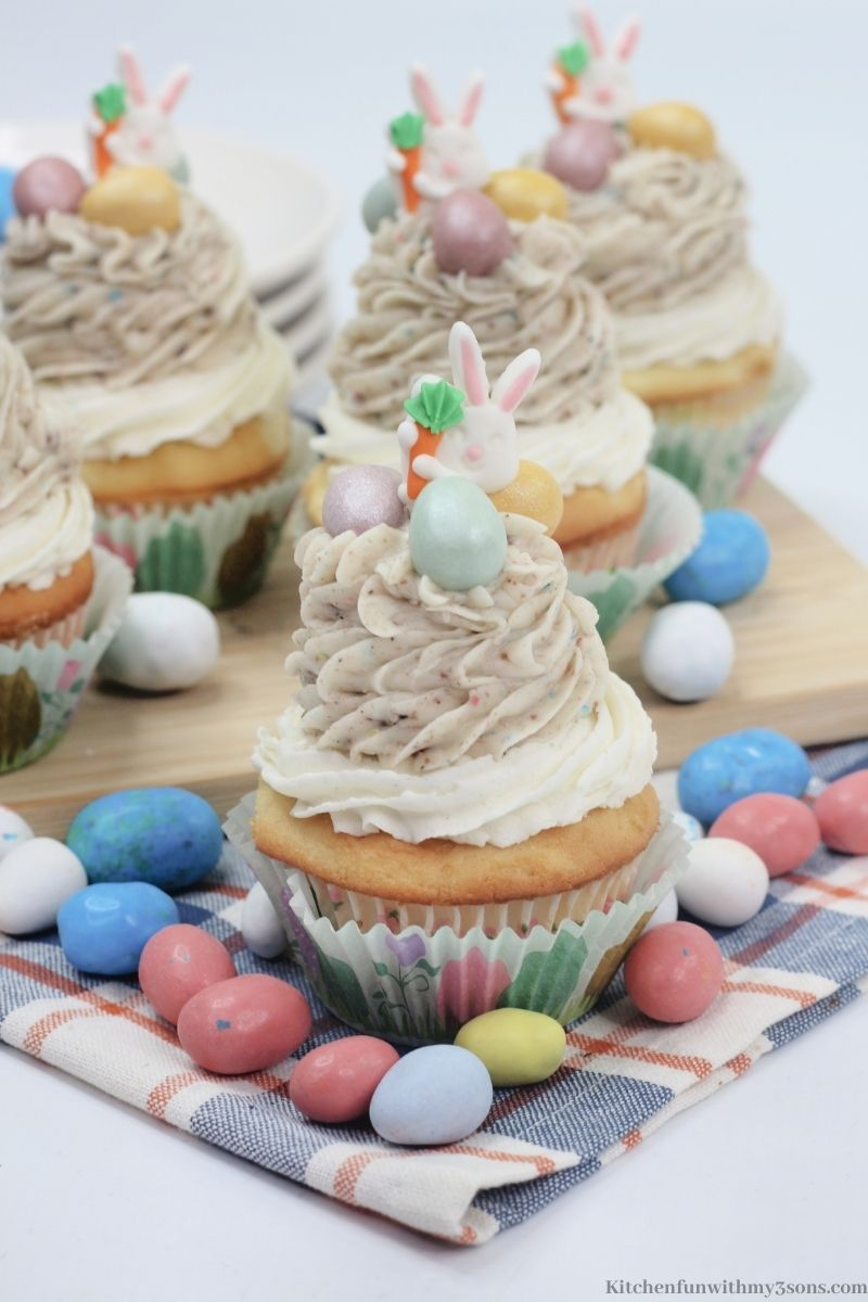 Cupcakes with a bunch of robin eggs around them.