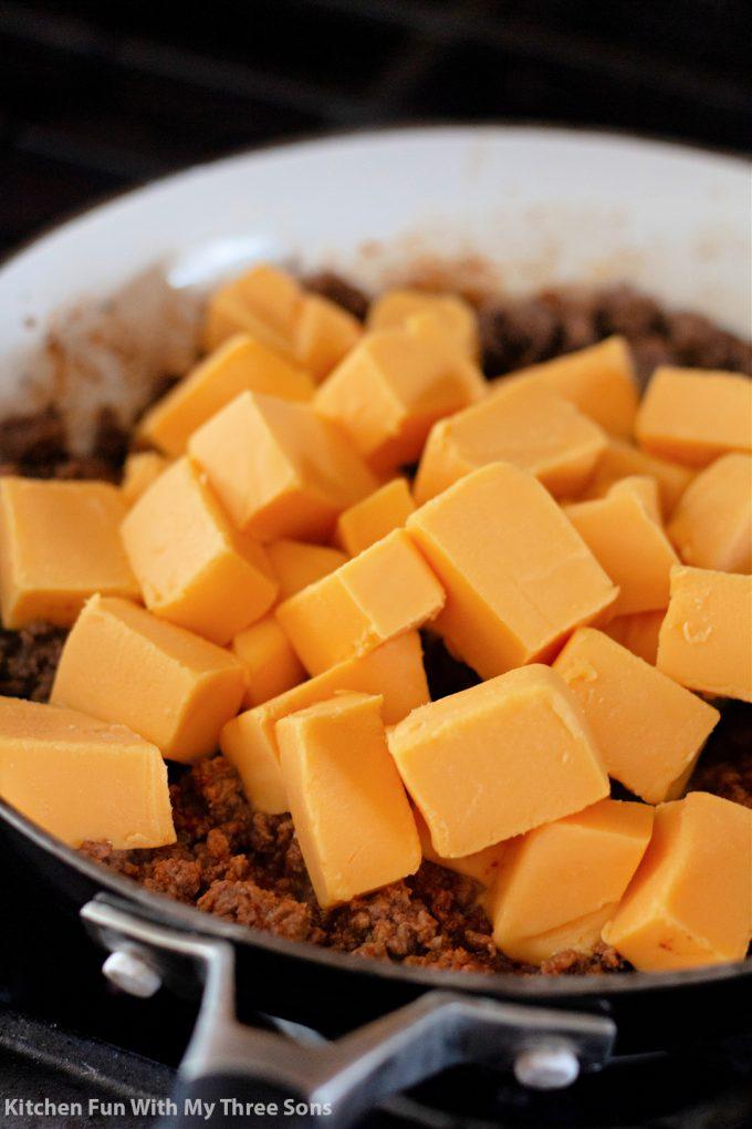 cubed Velveeta cheese over top of the ground beef.