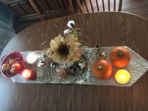 kitchen table fall decor with pumpkins