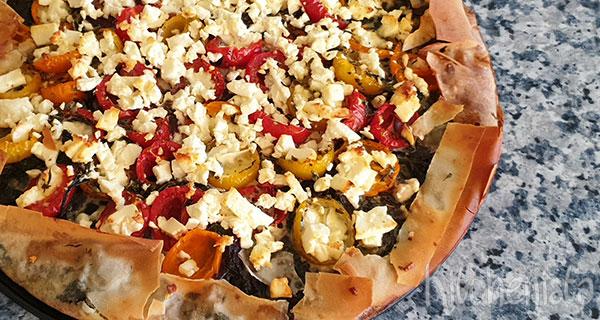 Hartige taart met spinazie, feta en tomaat