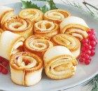 Broodrolletjes met rauwe ham en kruidenboter