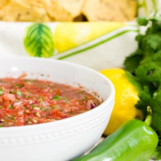 Fresh Salsa made with your food processor. Easy recipe and delicious. Makes a lot of salsa and it's the perfect appetizer, salad dressing, and toping for your favorite Mexican dishes. Make in 10 minutes or less and store in the refrigerator.