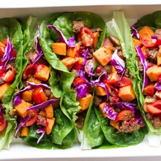 Paleo Lettuce Wraps: made with sweet potato, bison, sautéed veggies and a raspberry habanero hot sauce. Naturally seasoned and delicious.