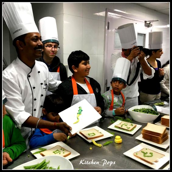 Chef assists children at Le Meridien New Delhi Family Club workshop with Princess Pea