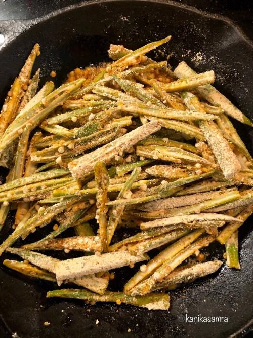 Cooking kurkuri bhindi. Easy bhindi recipe from Punjab.