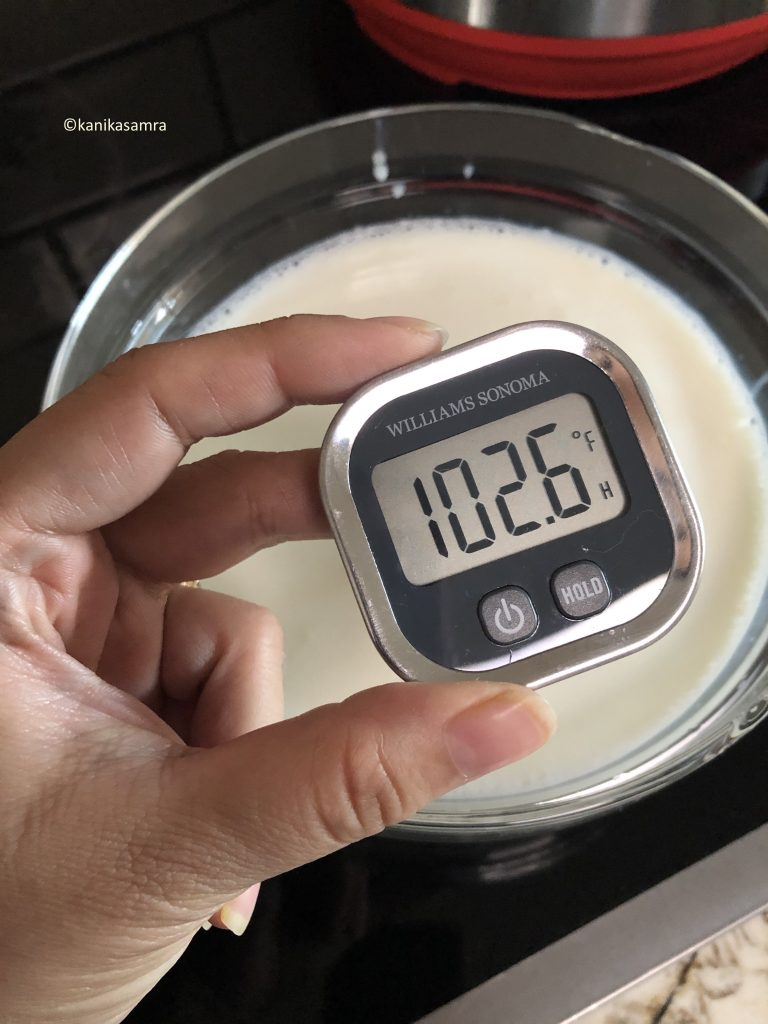 Lukewarm milk with thermometer