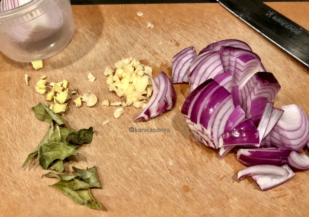 Tadka ingredients - onion, ginger, garlic and curry leaves