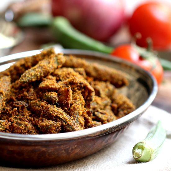 The prepared Bhindi Masala is placed in a oval dish