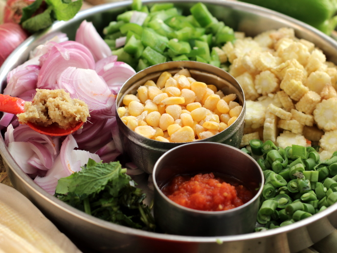 Ingredients for the sweet corn pulao are prepped and ready