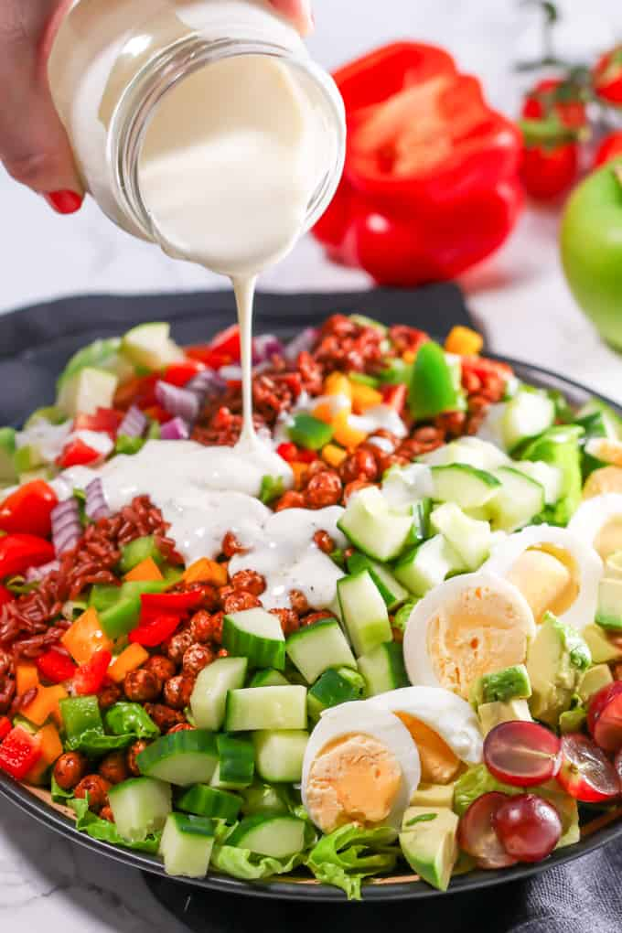 A colourful chopped cob salad with smoky chickpeas and goat's cheese dressing!