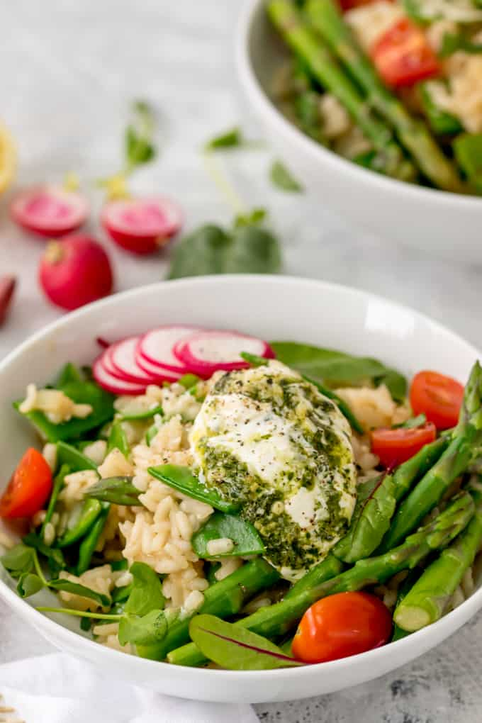 This Spring Vegetable Risotto with Creamy Pesto is creamy, cheesy and totally moreish! A fab gluten free and vegetarian dinner!