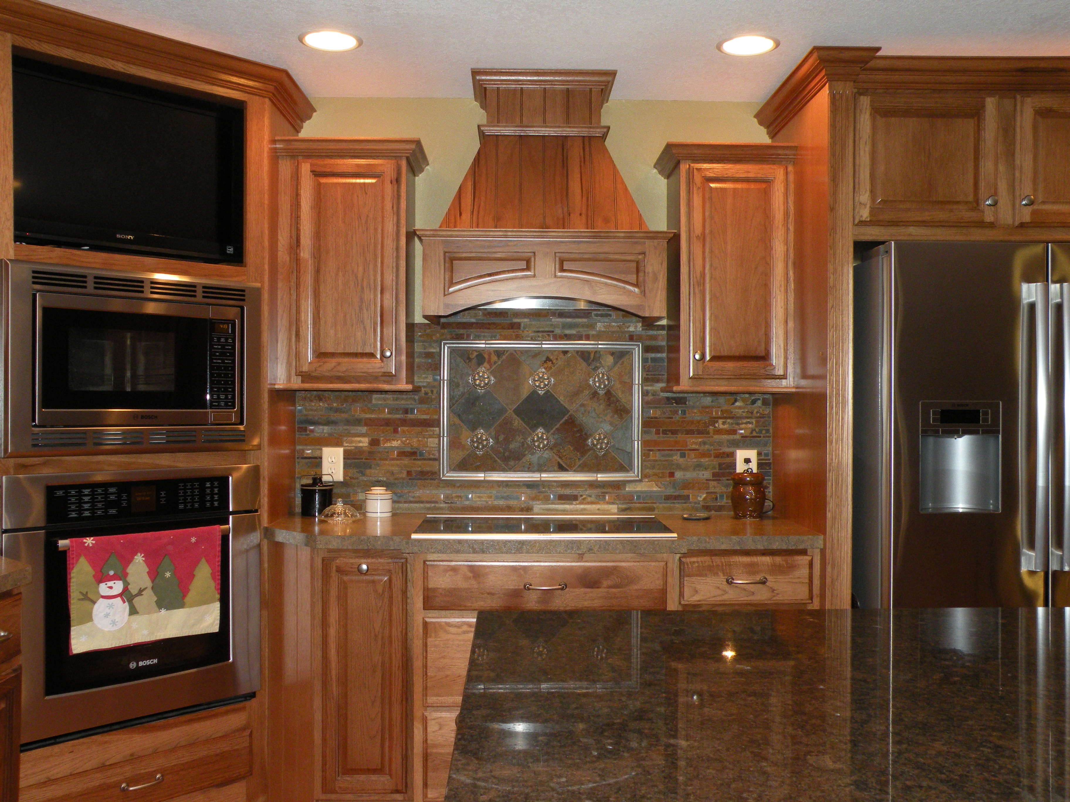 Kraftmaid Hickory Belmont with Sunset Stain  Kitchens