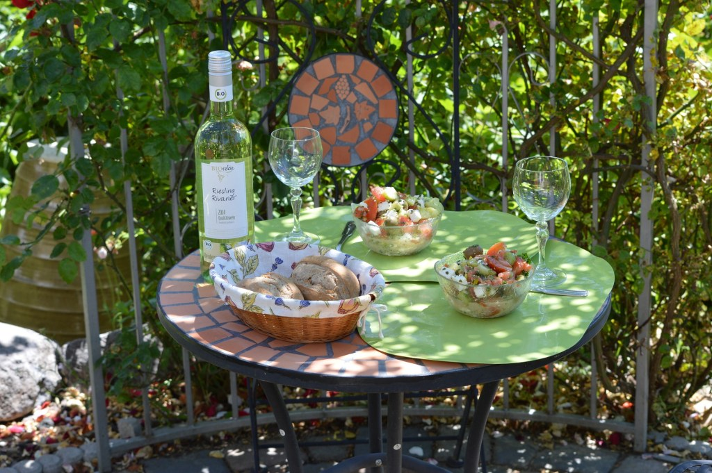 KitchenSpain: Table with wine, glasses, bread tray and salad