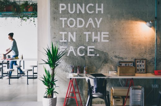 Punch today in the face written on the wall of a cowering space