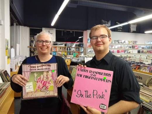 Mother and son holding albums for Larry Raspberry and the Highsteppers in a record store