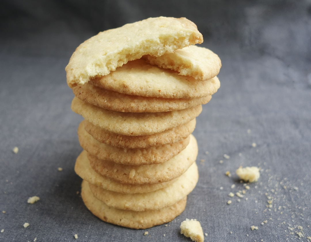 Thin crisp crunchy almond cookies that are soft and chewy at the center. The perfect for holiday cookies for family and friends. Homemade almond cookies makes a delicious after school snacks for kids