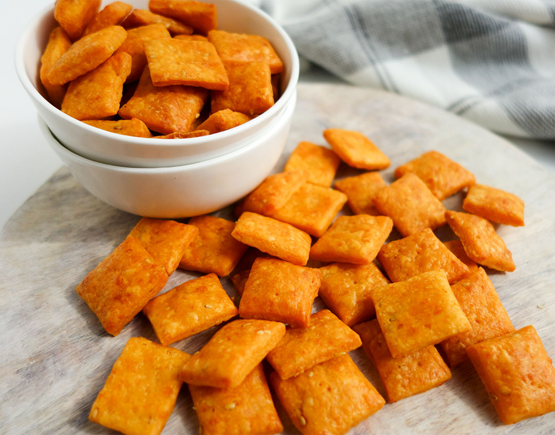 Simple and easy recipe for homemade spicy cheez its. They are eggless too. Perfect snacks for after school.