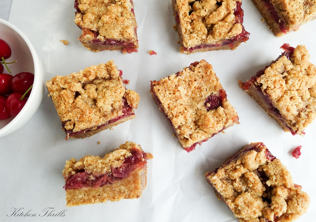 DIY oatmeal bars with a hint of cinnamon are baked to perfection and filled with fresh cherry filling.