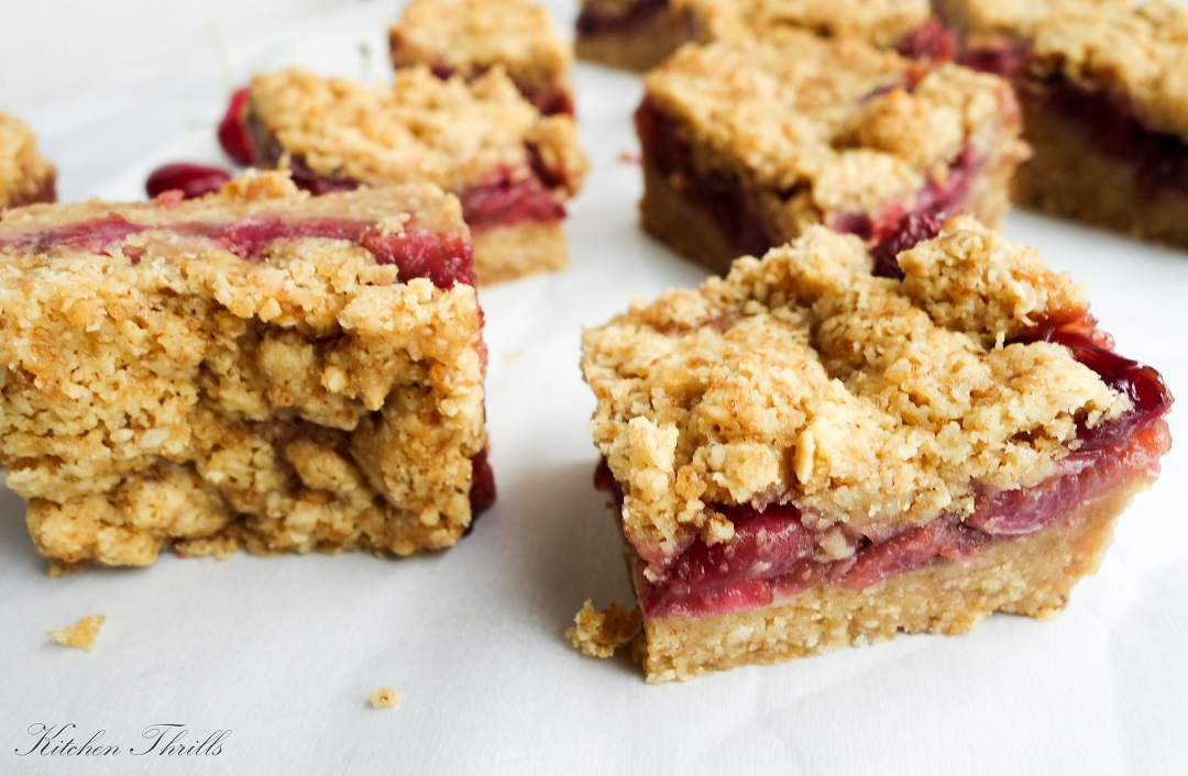 These soft, chewy crust with fresh cherry filling and topped with a crunchy oatmeal crumble makes these bars the best holiday dessert.