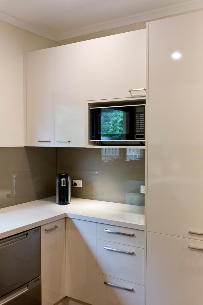 nantucket polar white kitchen cabinets ashley furniture island new doors in laminex moleskin benchtops