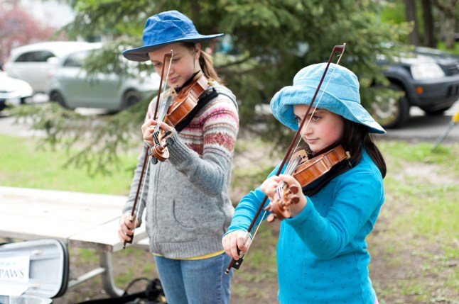 Helen and May Engelhardt 12 and 9 entertain market goers while raising money for the Canadian Parks and Wilderness Society