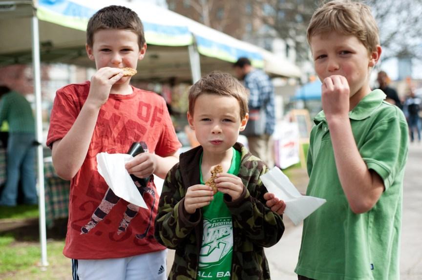 Jack McLeod, 8, Benji McLeod, 6, and Dylan Scott Thomas, 8, enjoy fresh baked cookies