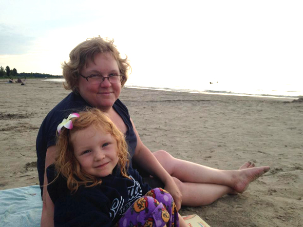 Hintonburg resident Vicky Smallman and her daughter Audrey are already getting started on their beach reading.
