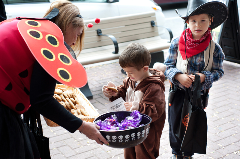 Westboro kids Jamie Dryad (6), and brother Ben (2) enjoy fresh cookies from lovely ladybug Shirley Trench of Simply Biscotti.